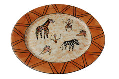 African Art on Platter Isolated. Image of african art or cavedrawings of african wildlife on platter isolated Stock Images