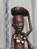 African art style. Wooden african statue and fence Royalty Free Stock Photos
