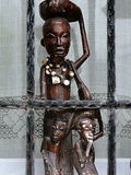 African art style. Wooden african statue,leaves and fence Royalty Free Stock Photos