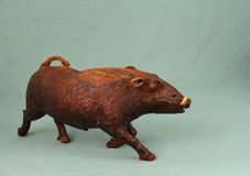 African art - wart hog carved from solid wood stock photo