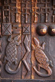 African art wood carving design. African art wood carving on brown door Stock Photography
