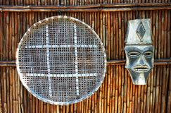 African Artworks on Bamboo Wall. African artworks hanging on bamboo wall Stock Photography
