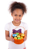 African Asian girl holding chocolate ester egg Royalty Free Stock Photography