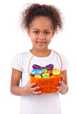 African Asian girl holding chocolate ester egg Royalty Free Stock Images