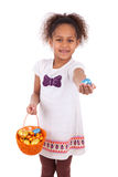 African Asian girl holding chocolate ester egg Stock Image