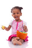 African Asian girl holding chocolate ester egg Stock Photos