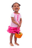 African Asian girl holding chocolate ester egg Royalty Free Stock Photo