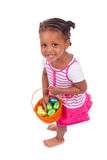 African Asian girl holding chocolate ester egg Royalty Free Stock Photos