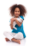 African Asian girl holding a rabbit Stock Photo