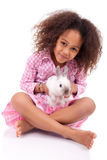 African Asian girl holding a rabbit Royalty Free Stock Photos