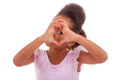 African Asian girl making heart shape sign Stock Images
