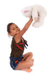 African Asian girl playing with a teddy bear Royalty Free Stock Photography