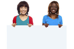 African and Asian marketing personnel. Holding billboard isolated against white background royalty free stock image