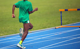 African athlete during the Hurdling  race. Young African athlete during the Hurdling  race Stock Images