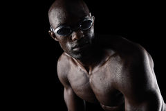 African athlete with swimming goggles looking away Stock Images
