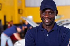 African auto mechanic. Close up portrait of happy african male auto mechanic stock photography