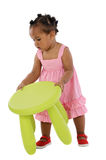 African baby catching the stool Stock Photo