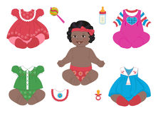 African_baby-girl. A african baby-girl with a set of clothes Stock Photo