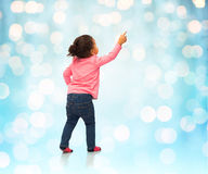 African baby girl pointing finger to something Stock Image