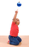 African baby girl pointing one ball of Christmas Royalty Free Stock Photo