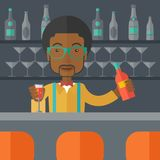 African bartender at the bar holding a drinks Royalty Free Stock Photos