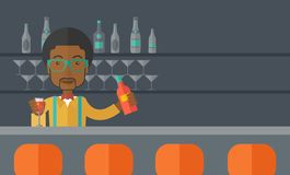 African bartender at the bar holding a drinks Royalty Free Stock Photo