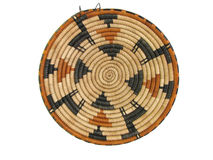African basket 4. Isolated brown and tan african coil basket with animal design Royalty Free Stock Image