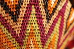 African basket. Textures, colours and patterns on a hand-woven African basket Stock Image