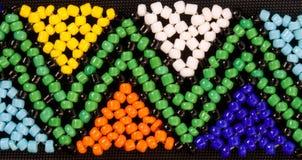African beadwork. Closeup of african beadwork in triangular geometric pattern Stock Photos