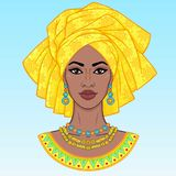African beauty. An animation portrait of the young black woman in a turban. Vector illustration isolated on a blue background. Print, poster, t-shirt, card vector illustration