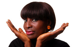 African beauty. A beautiful black woman with her chin in her hands Royalty Free Stock Images