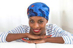 African beauty. Beautiful woman wearing a headscarf and looking at camera Stock Photography