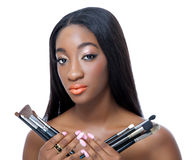 African beauty holding make up brushes stock photography