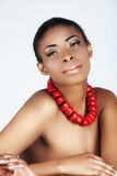 African beauty with red corals royalty free stock photos