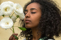 African beauty and roses Royalty Free Stock Photo