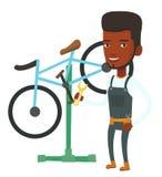 African bicycle mechanic working in repair shop. Stock Image