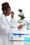 African biologist, medical student or doctor works in the office Royalty Free Stock Image
