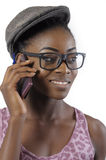 African or black American woman talking to cell phone. African or black American woman talking to cell mobile phone isolated Stock Photo