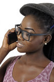 African or black American woman talking to cell phone. African or black American woman talking to cell mobile phone isolated Royalty Free Stock Photography