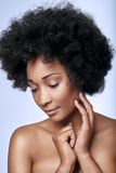 African black beauty in studio. Portrait of beautiful young black african model looking down with smooth complexion flawless skin, skincare beauty concept Royalty Free Stock Images