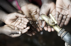 African Black Children with Hands Cupped under Clean Hygienic Wa. Litle African hands holding under tap to have water stock photo