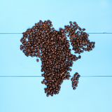 African black coffee. Flat layout of roasted grains forming outline the continent Royalty Free Stock Photography