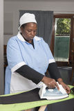 African black lady doing ironing Royalty Free Stock Images