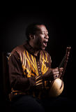 African black man with ethnic musical instrument Royalty Free Stock Image