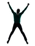 African black man jumping happy silhouette Stock Photos