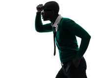 African black man looking away worried silhouette. One african  black man looking away worried  in silhouette studio on white background Royalty Free Stock Photography