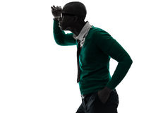 African black man looking away worried silhouette. One african black man looking away worried in silhouette studio on white background Royalty Free Stock Photo