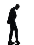 African black man standing looking down  silhouette Stock Photos