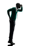 African black man standing tiptoe looking away silhouette Stock Image