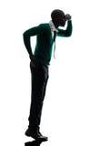 African black man standing tiptoe looking away silhouette Stock Image